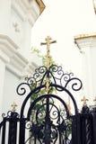 Christian church gate. Wrought church iron gate with cross Stock Photos