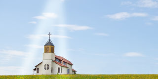 Christian church. On green field with light beam Royalty Free Stock Photo