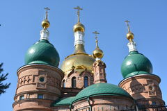 Christian church with green and gold open-air domes Royalty Free Stock Photo