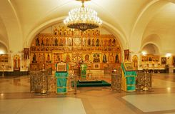 Christian church inside. (For illumination use special yellow lamps that all looked gold Stock Images