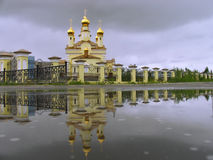 The Christian Church and its reflection in the water. Stock Photos