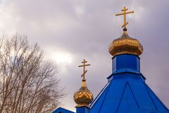 Christian church in Kemerovo with golden and gilded domes and bl stock image