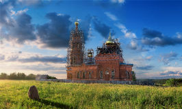 Christian church in the middle of Russia. Among green fields royalty free stock photo