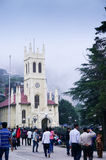 Christian church and people - mall road shimla. Shimla, India; 10th Aug 2013: Crowds roaming in front of the famous landmark church on mall road in shimla. Taken Royalty Free Stock Image