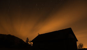 Christian Church in silhouette during a starry night and orange Stock Images