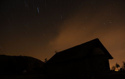Christian Church in silhouette during a starry night and orange Royalty Free Stock Images