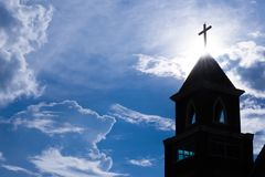 Christian church silhouetted flare sunlight background Stock Photos