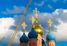 Christian church in the sun and a crane. Russia Royalty Free Stock Photos