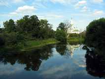 Christian church at Suzdal. The picture of the Russian christian church at the Suzdal town near the lake, surronded by trees stock photography