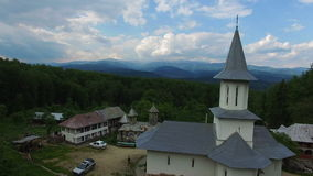 Christian church on top of green hill, aerial view, camera rising stock video