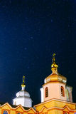 Christian church under the night sky with stars Royalty Free Stock Photos