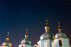 Christian church under the night sky with stars Stock Images