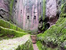 Christian church walls in Africa. Green verdant landscape in the highlands of Ethiopia, a Christian church stands above a moat Stock Images
