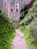 Christian church walls in Africa. Green verdant landscape in the highlands of Ethiopia, a Christian church stands above a moat Stock Photos