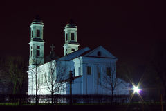 Christian classical white church at night. Christian classical Saint Jacob white church in Jonava Lithuania at night time Stock Photography