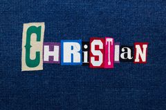 CHRISTIAN collage of text and word, multi colored fabric on blue denim, Christianity religion diversity concept. Horizontal aspect stock photography