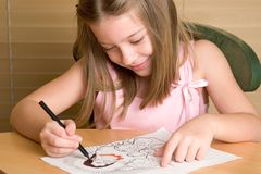 Christian Coloring Book 2. A young girl coloring in a Christian coloring book royalty free stock photos