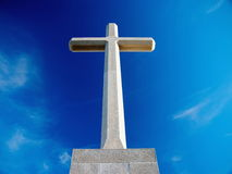 Christian cross 2. Big Christian cross over blue sky and clouds - bottom racurs Stock Images