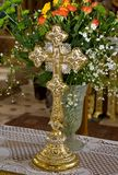 Christian cross. In church with flowers decoration for baptism stock photography