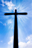 Christian cross. A christian shining cross on the blue cloudly sky, monument on the hill Royalty Free Stock Photos