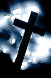 Christian cross. Christian wooden cross surrounded by light spots royalty free stock image