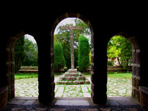 Christian cross. Religious courtyard view from inside a church Royalty Free Stock Image