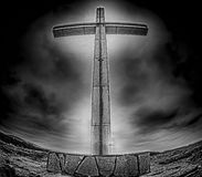 Christian cross. Abstract fisheye view of christian cross and clouds in black and white royalty free stock photos