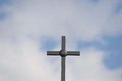 Christian Cross. Cross against the blue sky stock photos