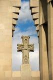 Christian cross against blue sky. Christian cross against cloudy blue sky Royalty Free Stock Photography