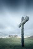 Christian cross against the sky and rolling hills Stock Image