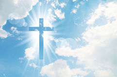 Christian cross appears bright in the sky. Background Royalty Free Stock Photo