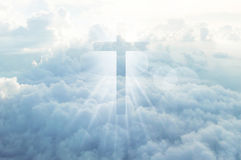 Christian cross appears bright in the sky Royalty Free Stock Photography