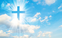 Christian cross appears bright in the sky Stock Image