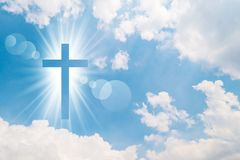 Christian cross appears bright in the sky Stock Images