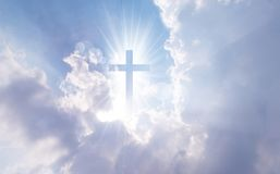 Christian cross appears bright in the sky. Background Royalty Free Stock Photography