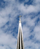 Christian cross atop of church steeple with clouds Royalty Free Stock Photo