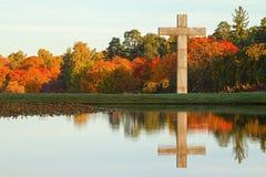 Christian cross in autumn landscape. Stock Image