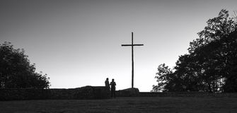Christian cross backlight. Black and white photo. Wooden Christian crucifix backlight silhouette, standing on the backyard viewpoint at the Sanctuary of La Verna royalty free stock photos