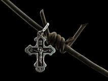 Christian cross on a barbed wire Royalty Free Stock Photos
