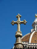 Christian cross with Basilica in background Royalty Free Stock Images
