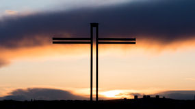 Christian Cross with beautiful sunset Stock Photos
