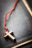 Christian Cross on Bible Stock Image