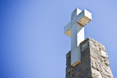 Christian cross in blue background - image with copy space.  stock images