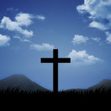 Christian Cross. With blue sky and cloud background Stock Images