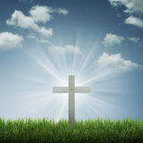 Christian Cross. With blue sky and cloud background. With ray of light effect royalty free stock photo