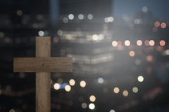 Christian Cross. With blurry city at night Stock Photography
