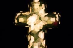 Christian cross bokeh. Christian cross with bokeh light background royalty free stock images