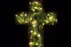 Christian cross bokeh. Christian cross with bokeh light background royalty free stock photography