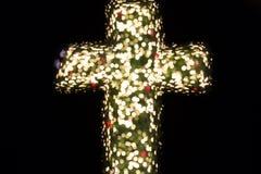 Christian cross bokeh. Christian cross with bokeh light background stock photo