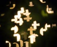 Christian cross bokeh. Christian cross with bokeh light background stock images